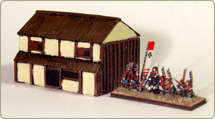 A large warehouse with miniatures from Baccus 6mm for size comparison