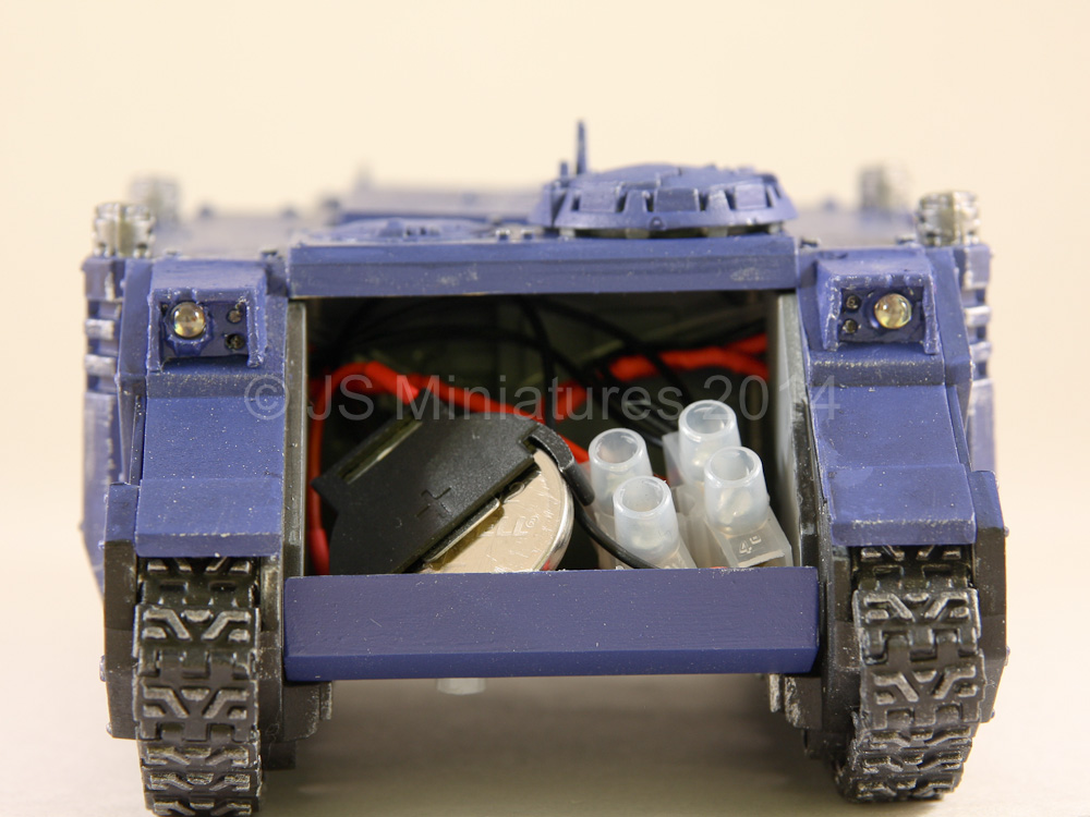 Battery and wiring can be stored in the front of the tank with the on-off switch underneath