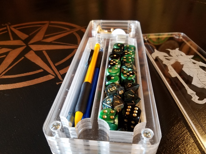 There is plenty of room for your favorite dice, writing utensils, and miniatures