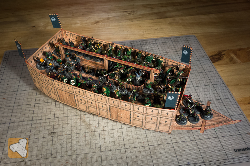 75 minis (1-inch base) fit on the deck of the big boat